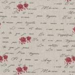 Tissu imprimé lin et coton roses rouges et écriture